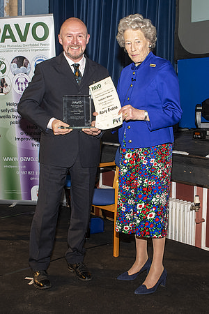 Rory Evans accepting his award from Shân Legge-Bourke